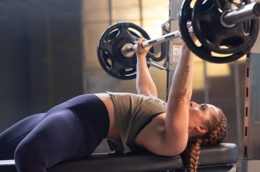 hot girl using Weight Bench