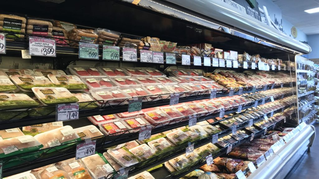 Picture of whole foods at a grocery store like chicken/ pork/ steak, good examples of what your protein intake should consist of.
