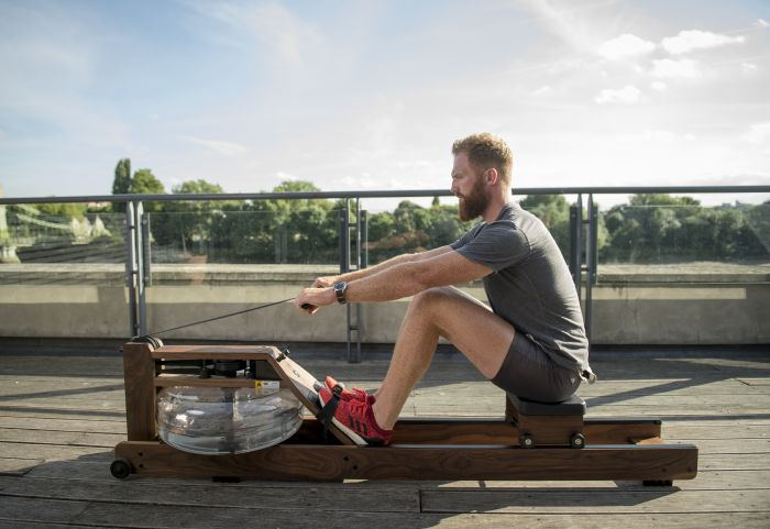 man using rowing machine
